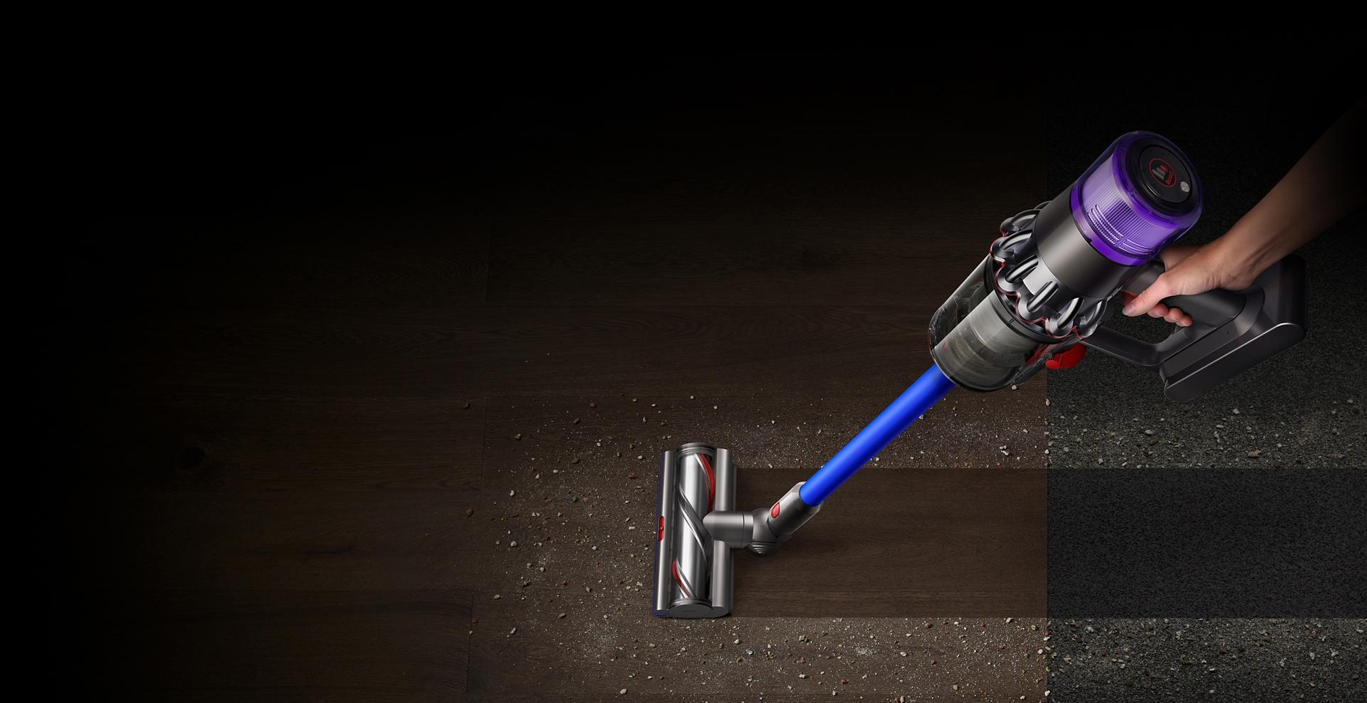 A Dyson V11™ vacuum picking up fine dust, allergens and pollen from the floor.