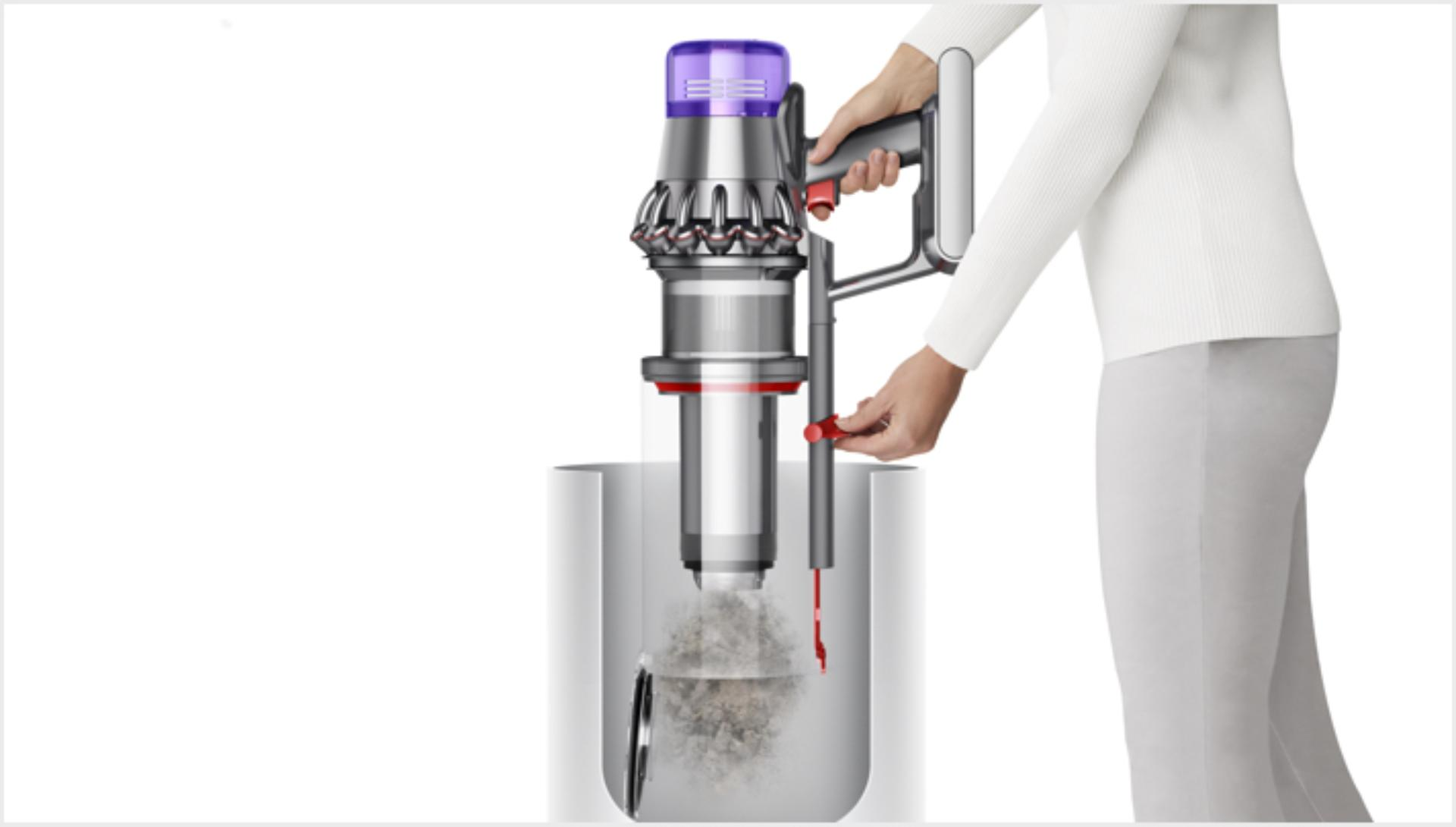 Woman emptying Dyson V11 Outsize vacuum into bin
