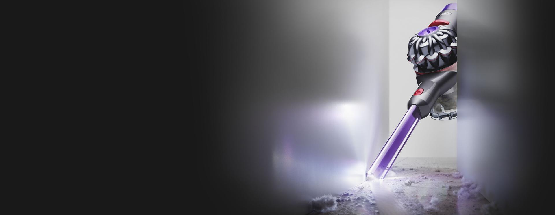 The Dyson V8 Slim Light-up crevice tool cleaning in a narrow gap
