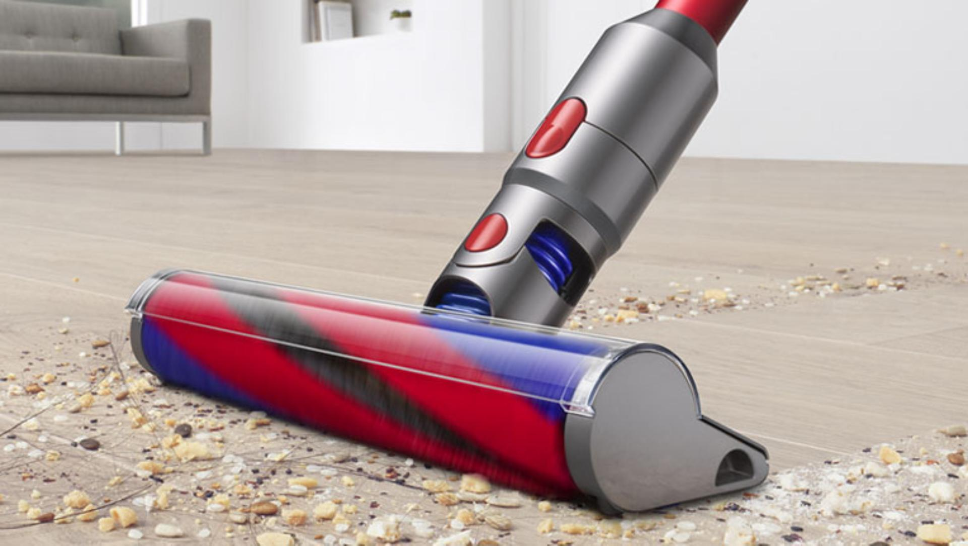 Dyson V8 Slim vacuum cleaning a carpet