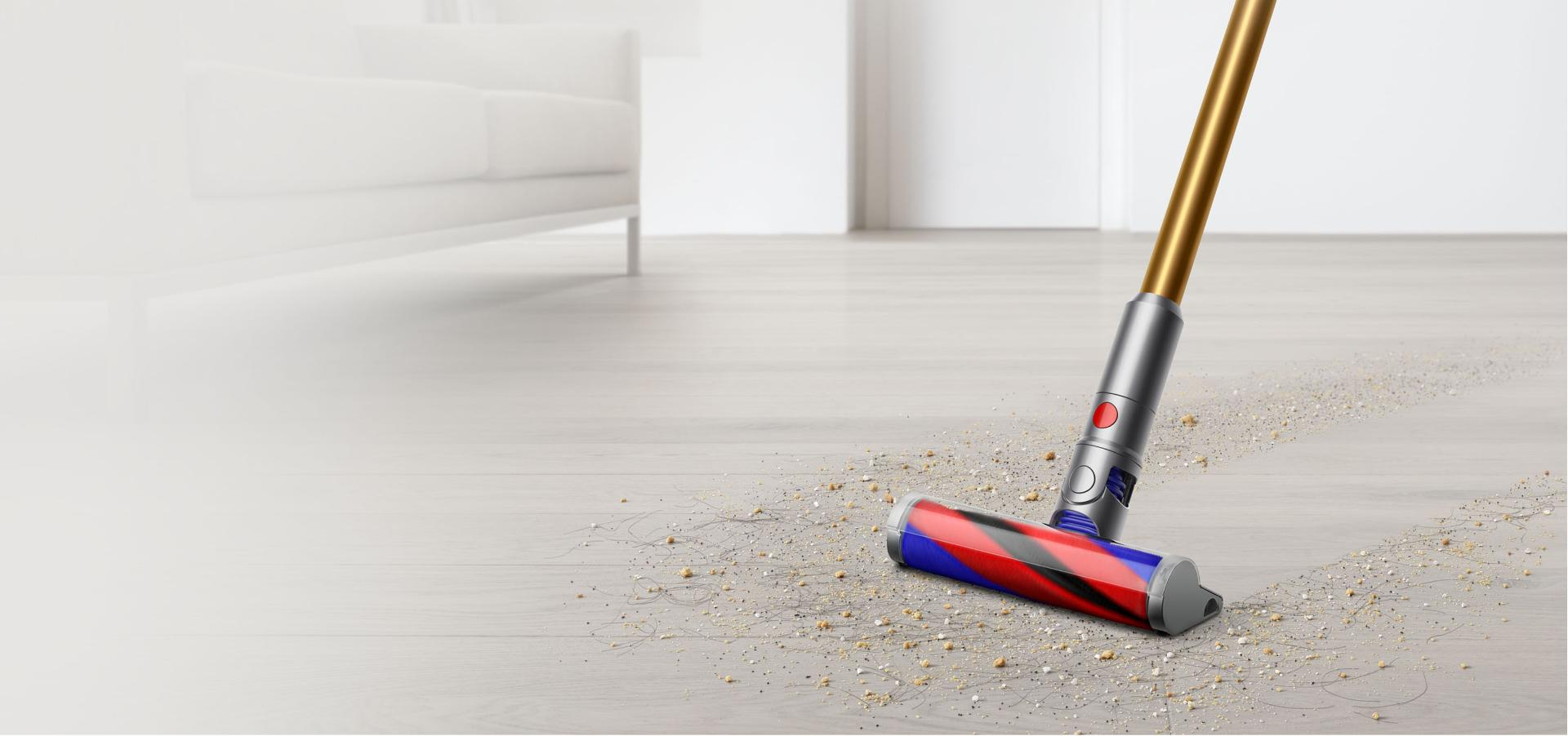 Dyson Micro 1.5kg cleaning debris from hard floor