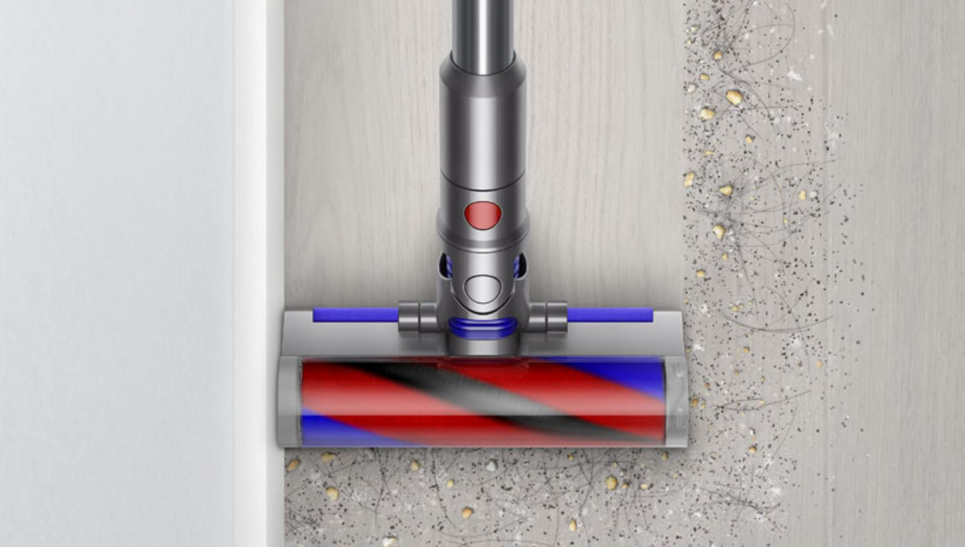 Dyson Micro 1.5kg cleaner head cleaning next to a wall.