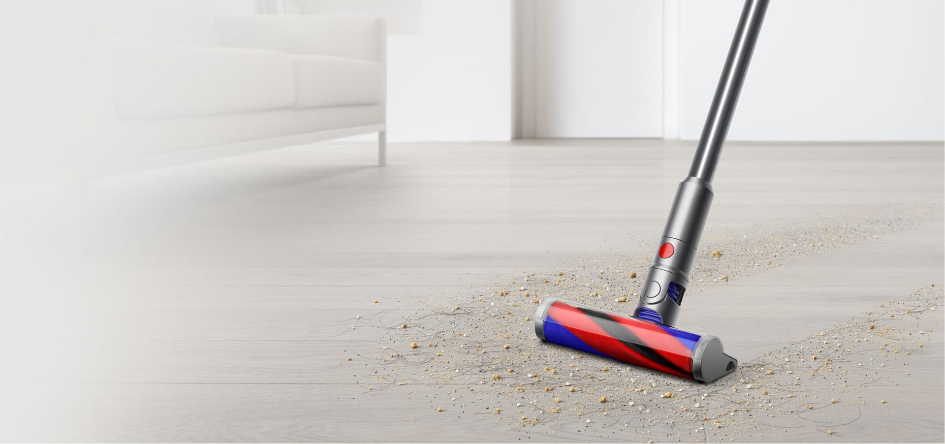 Dyson Micro 1.5kg cleaning debris from hard floor.