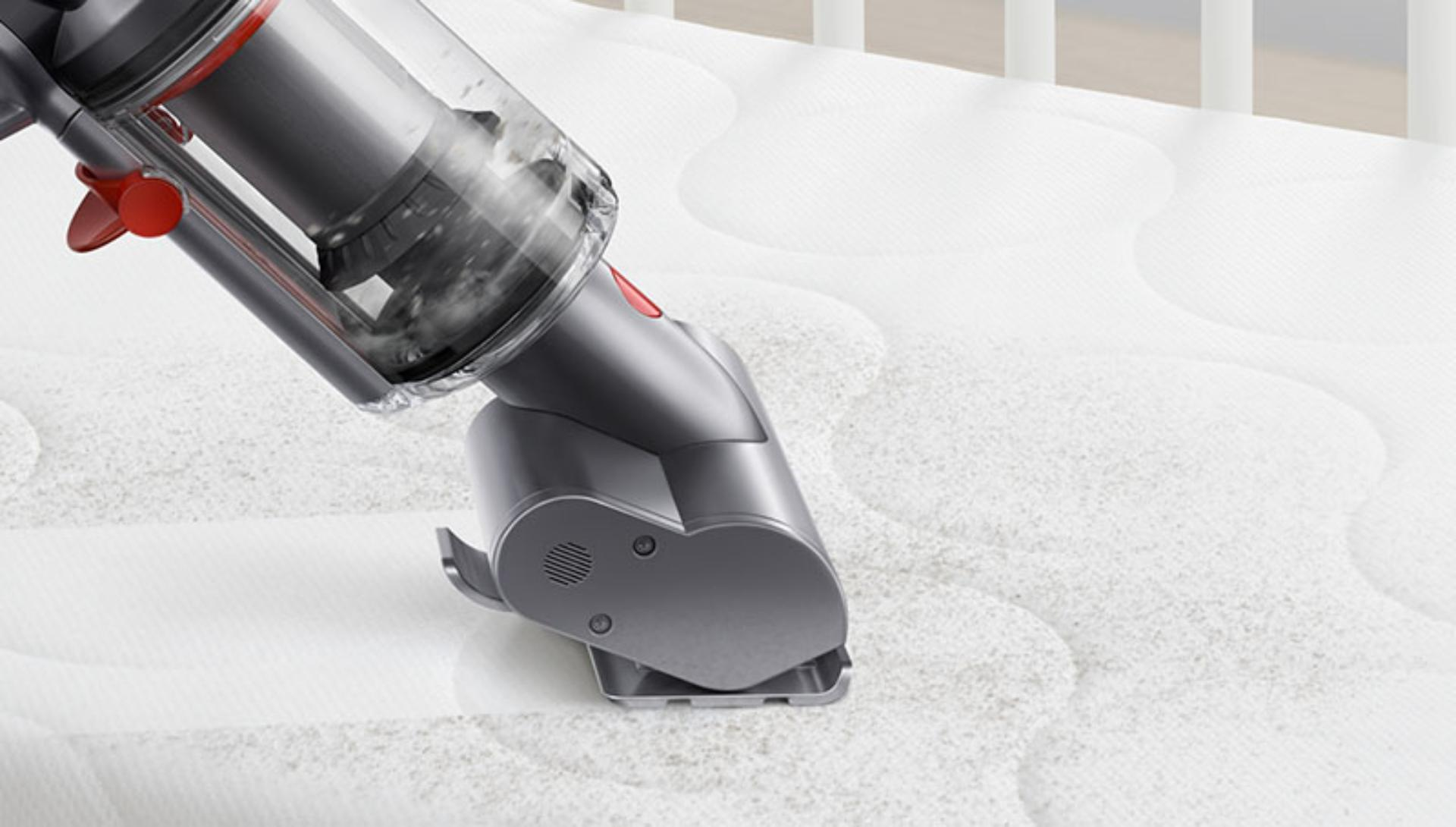 Dyson Micro 1.5kg vacuum cleaning a mattress.