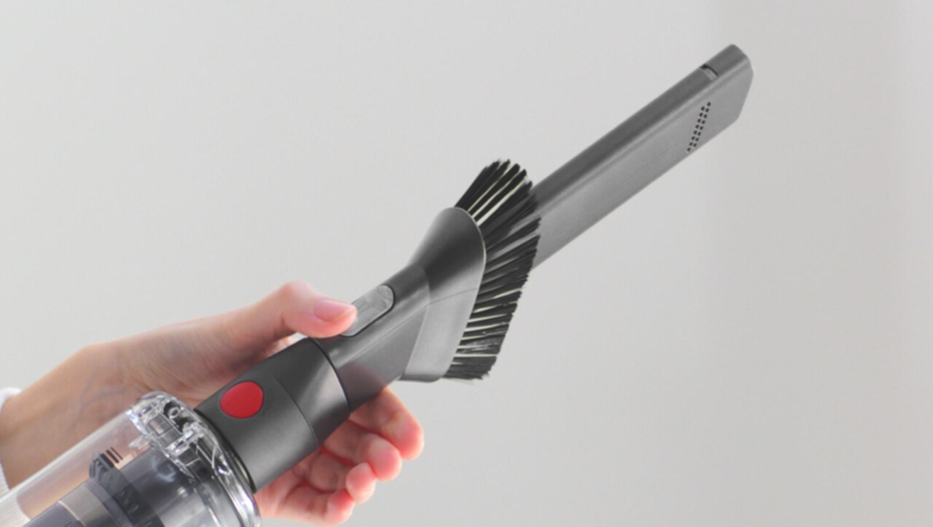 Combination tool showing crevice pipe and brush.