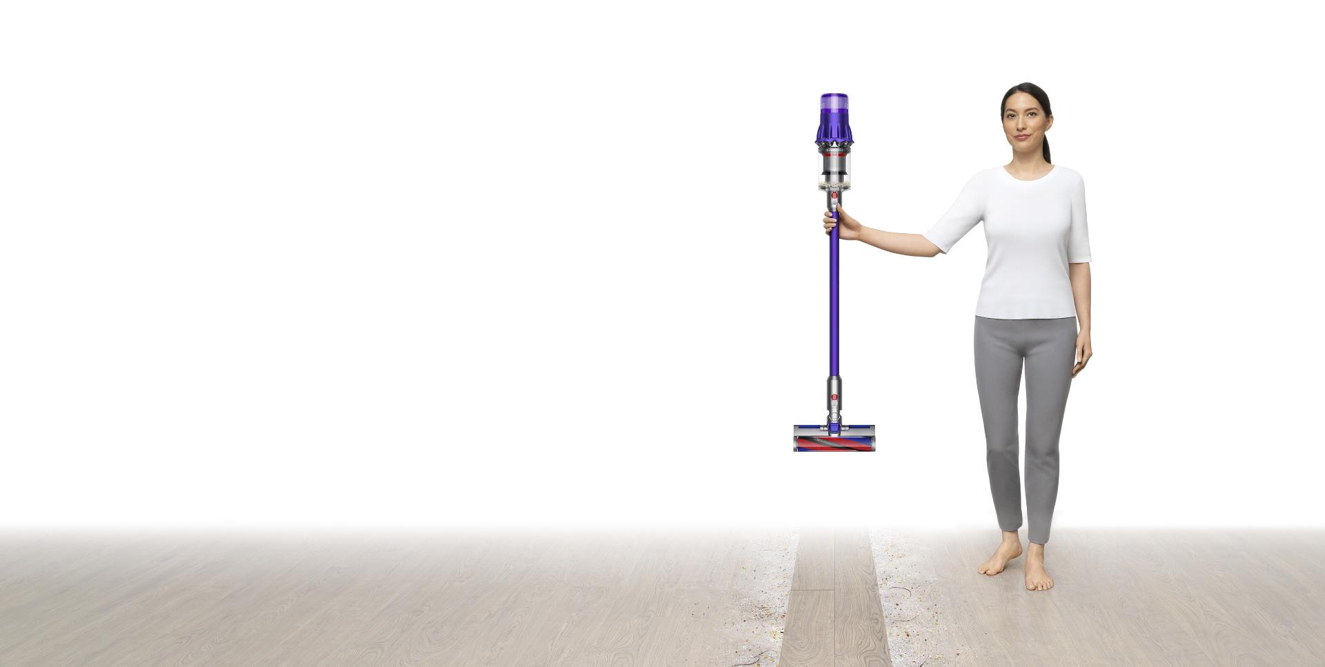 Image of a woman holding a Dyson Digital Slim™ vacuum.