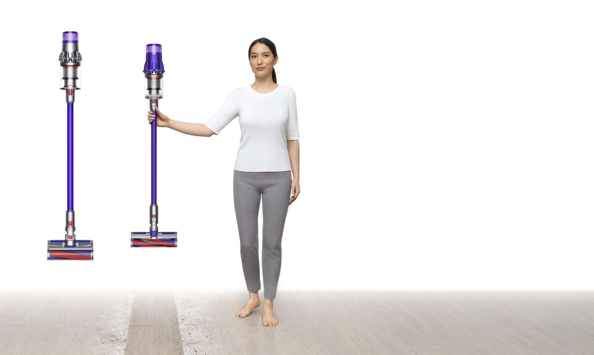 Image of a woman holding a Dyson Digital Slim™ vacuum alongside a V11™.