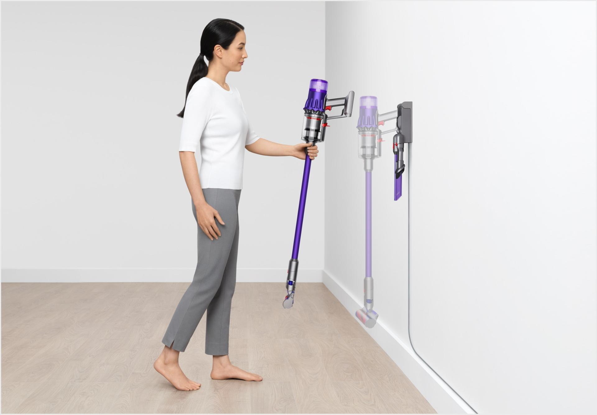 Dyson Digital Slim™ vacuum being placed into wall dock.