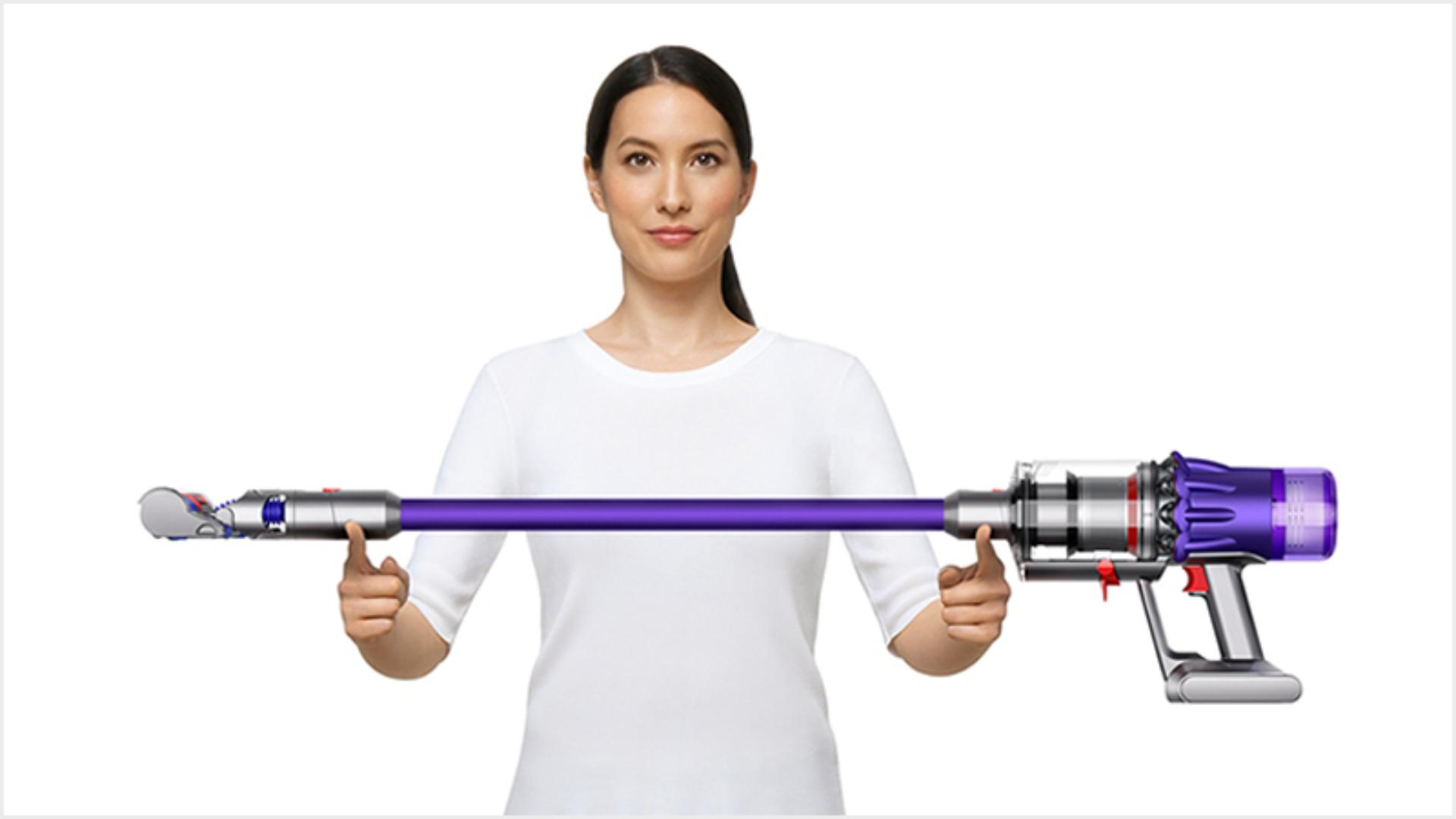 Woman lifting the Dyson Digital Slim vacuum