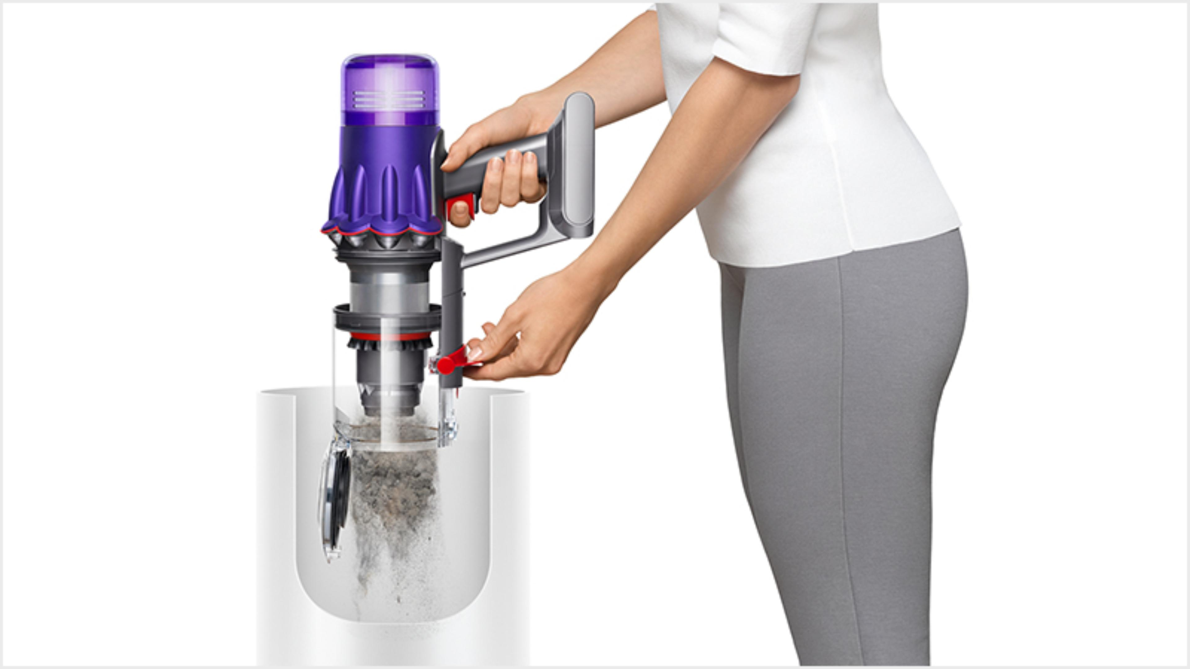 Woman emptying the Dyson Digital Slim vacuum into the bin