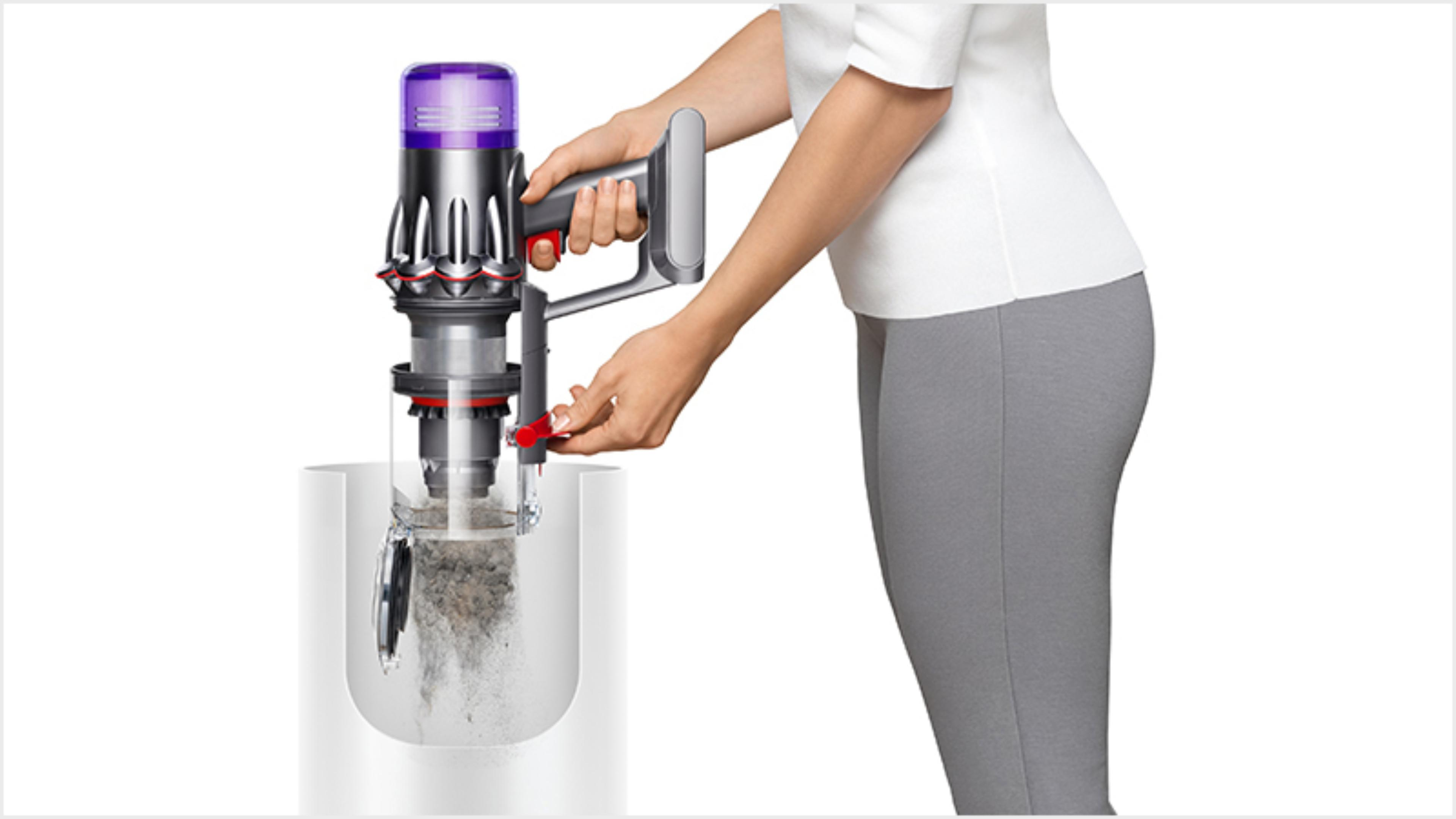 Woman emptying the Dyson Digital Slim vacuum into the bin