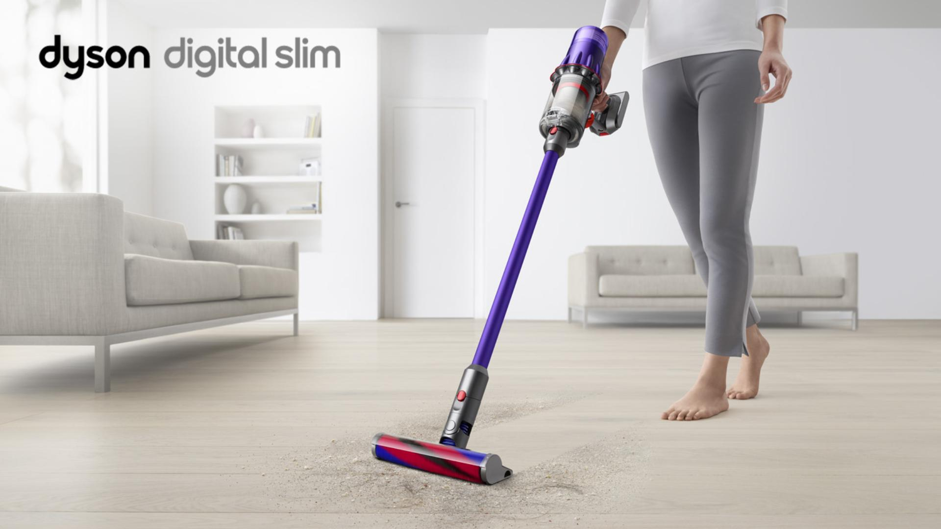 Image of a woman using a Dyson Digital Slim™ vacuum on a hard floor.