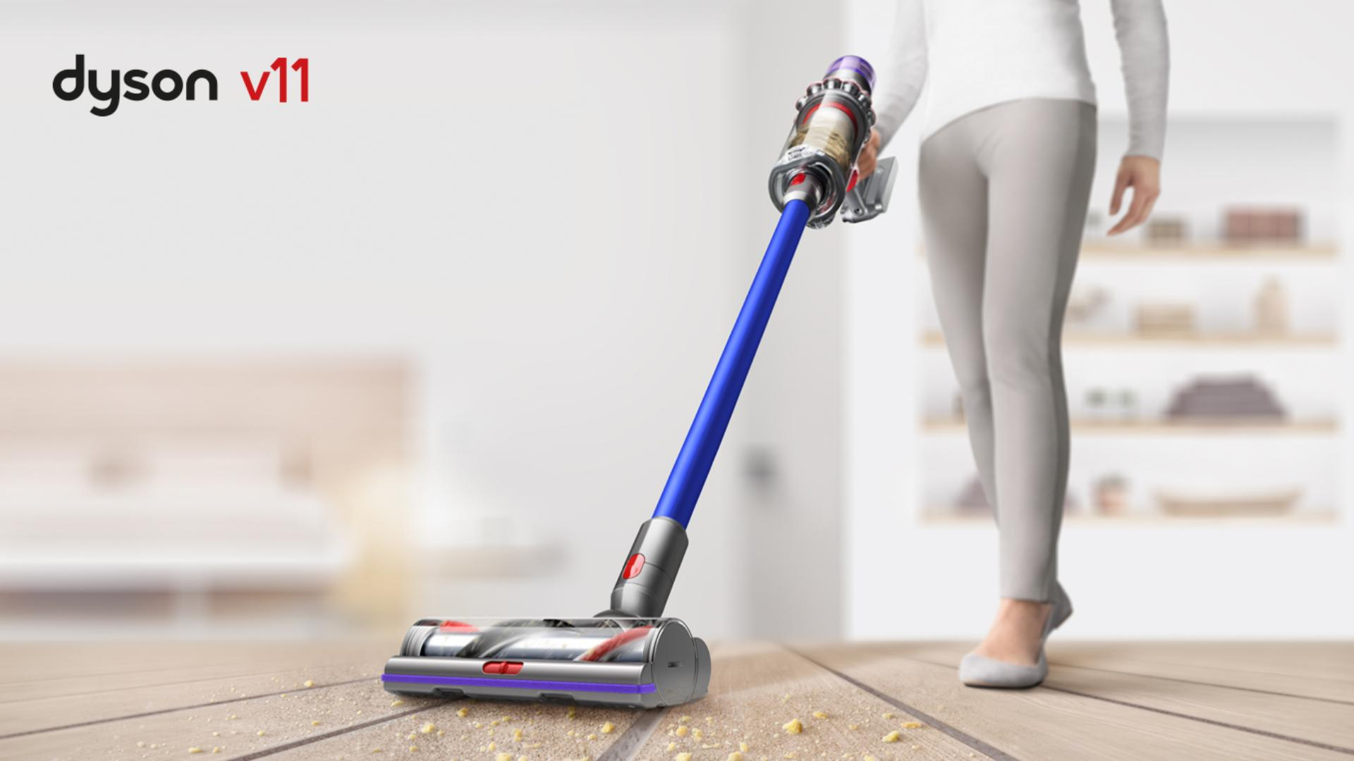 Woman using Dyson V8 to pick debris up from carpet