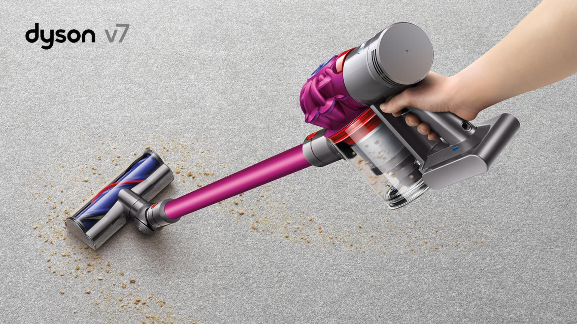 Woman using Dyson V7 to pick debris up from carpet