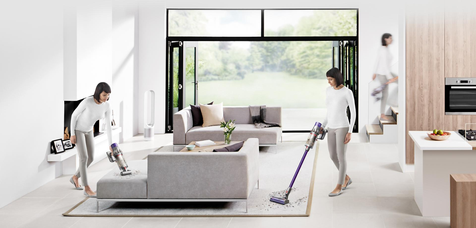 Woman using Dyson Cyclone V10 vacuum cleaner to clean a variety of areas around the home.