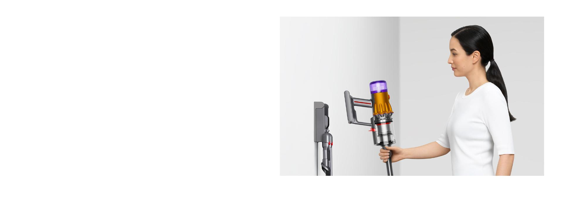 Plugging in the Dyson V12 Detect Slim vacuum