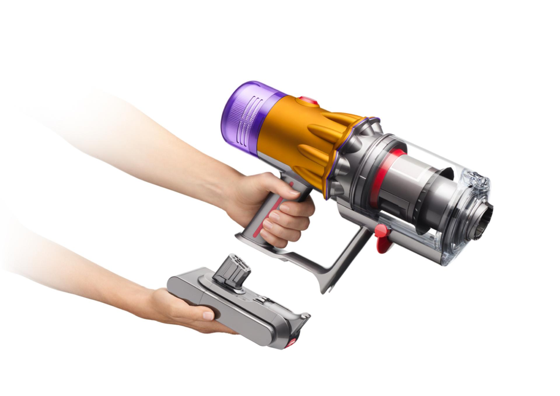 Battery being placed into dyson vacuum