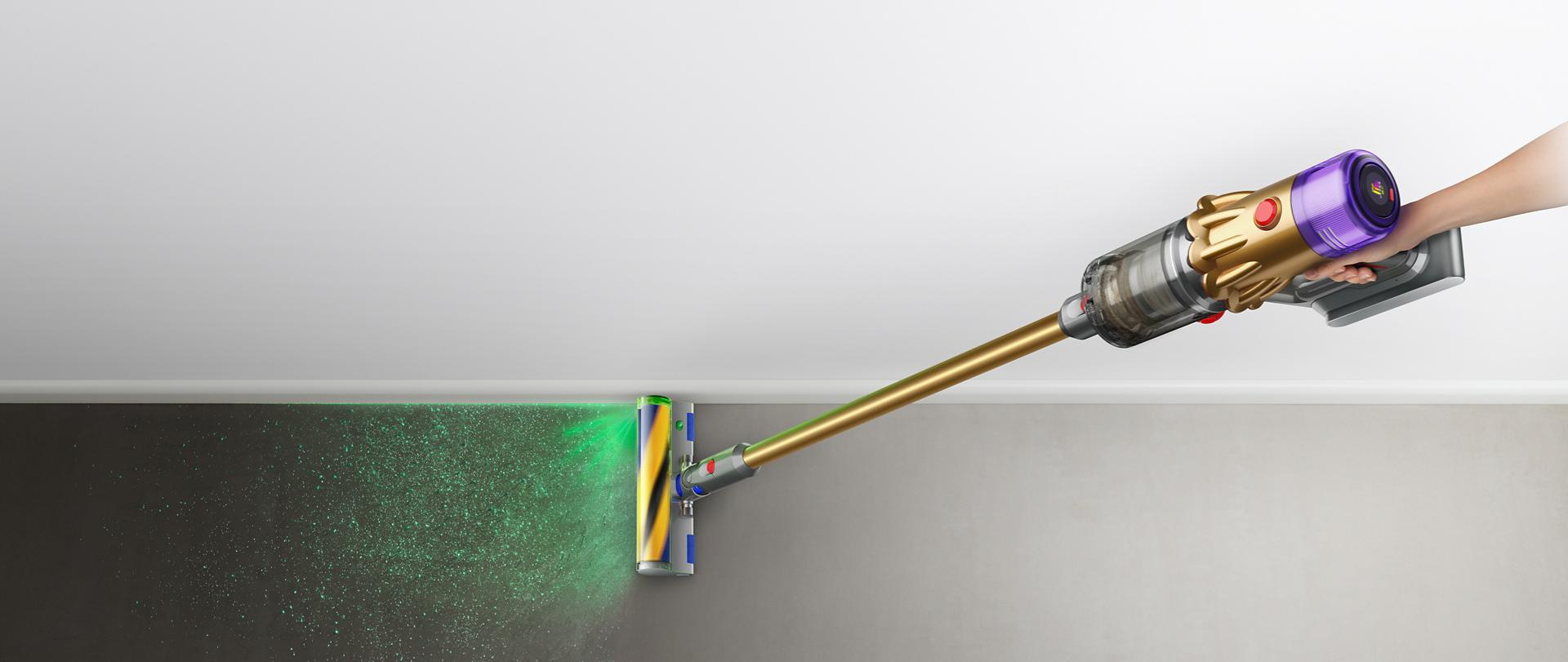 Close-up of hand holding the Dyson V12 Detect Slim vacuum