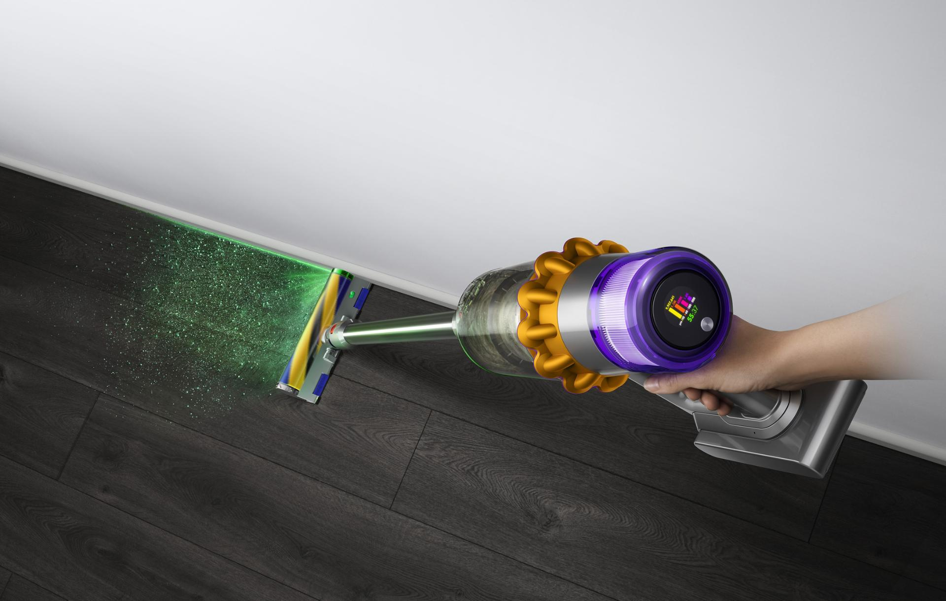 Close-up of hand holding the Dyson V15 Detect vacuum