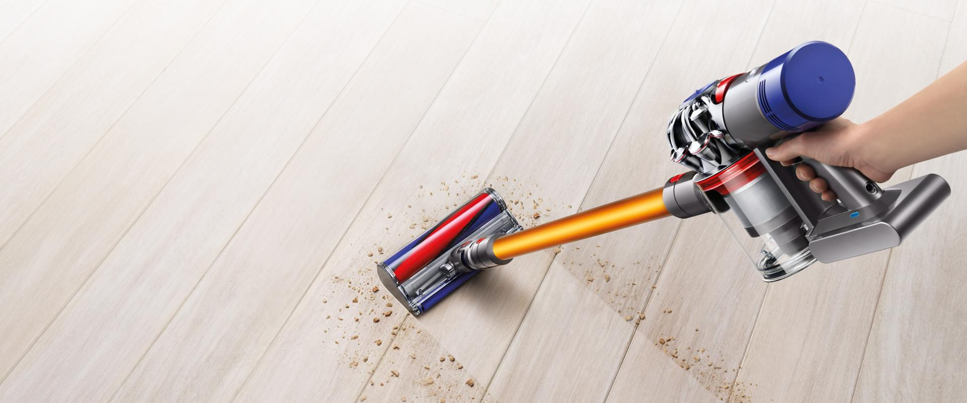 Dyson V8 vacuum cleaner picking up debris from carpet