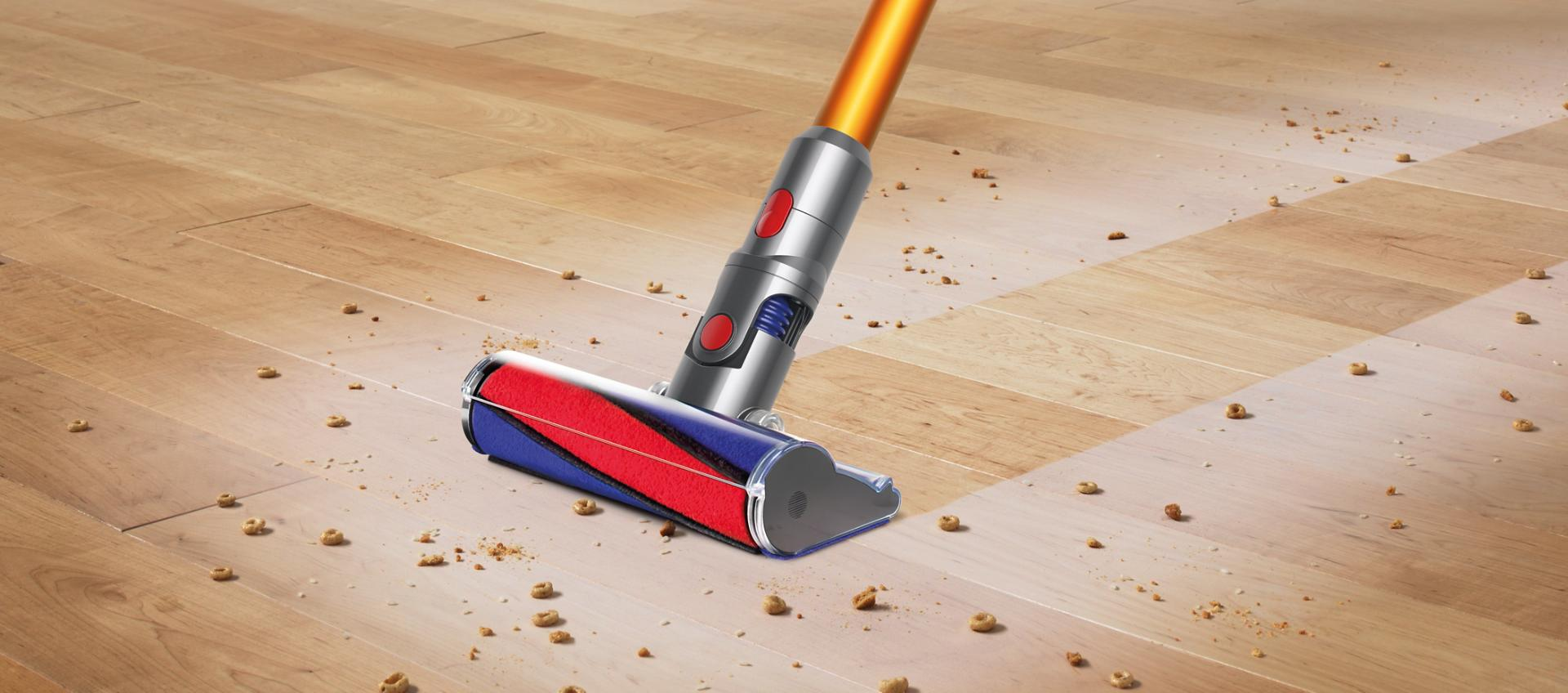 Two Dyson V8 vacuum cleaners cleaning side by side on carpet and hard floor