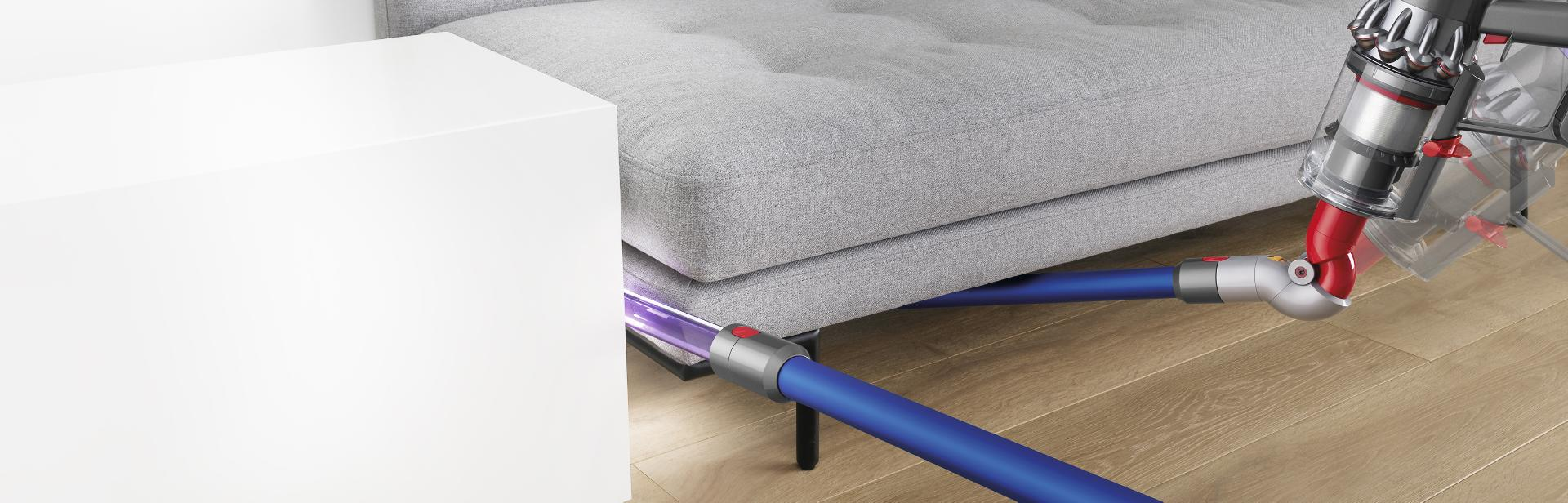 Dyson vacuum accessories cleaning a sofa