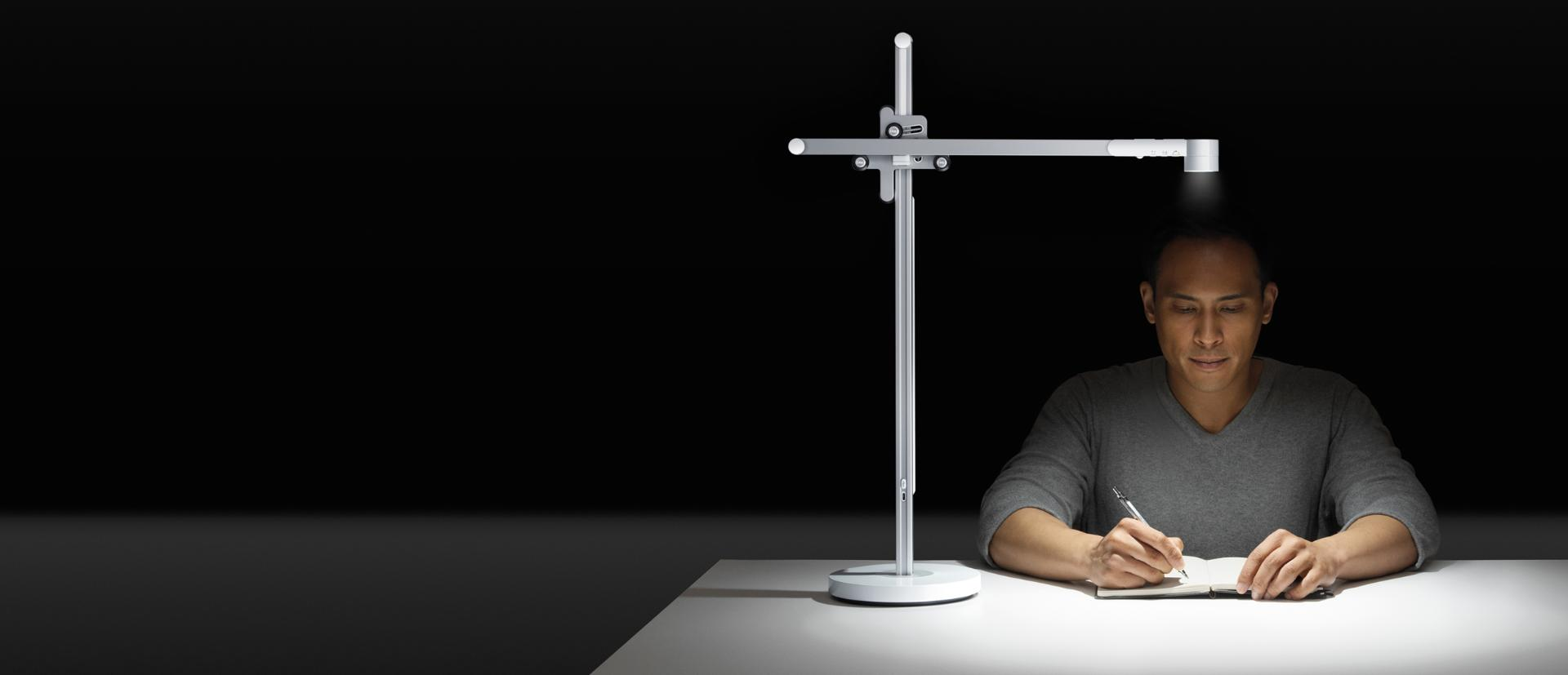 Man working under the Dyson Lightcycle task light