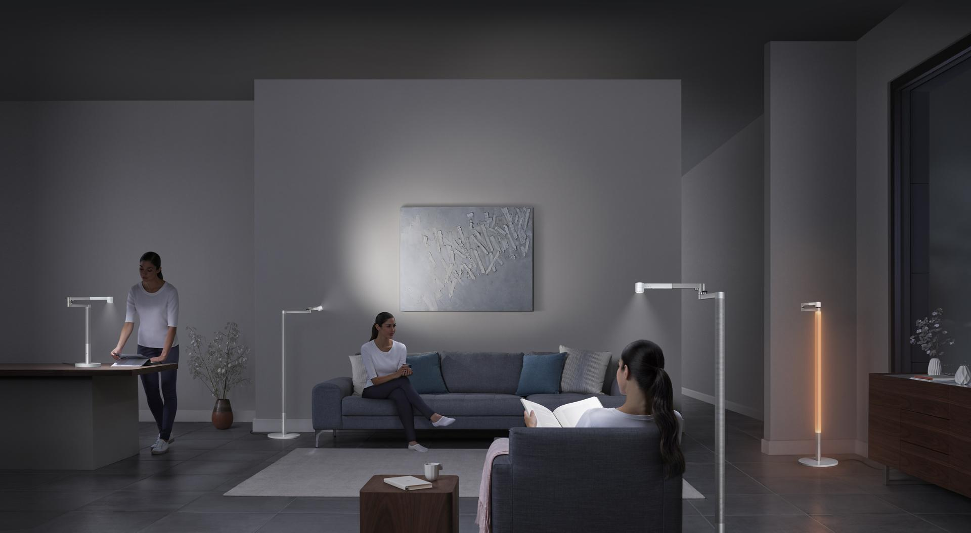 Multiple Dyson Lightcycle Morph lights being used in different ways in a room