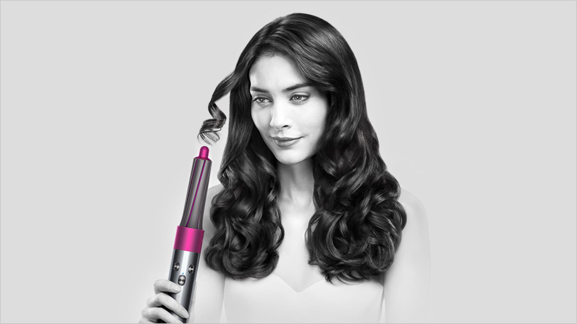 A model using the Dyson Airwrap styler