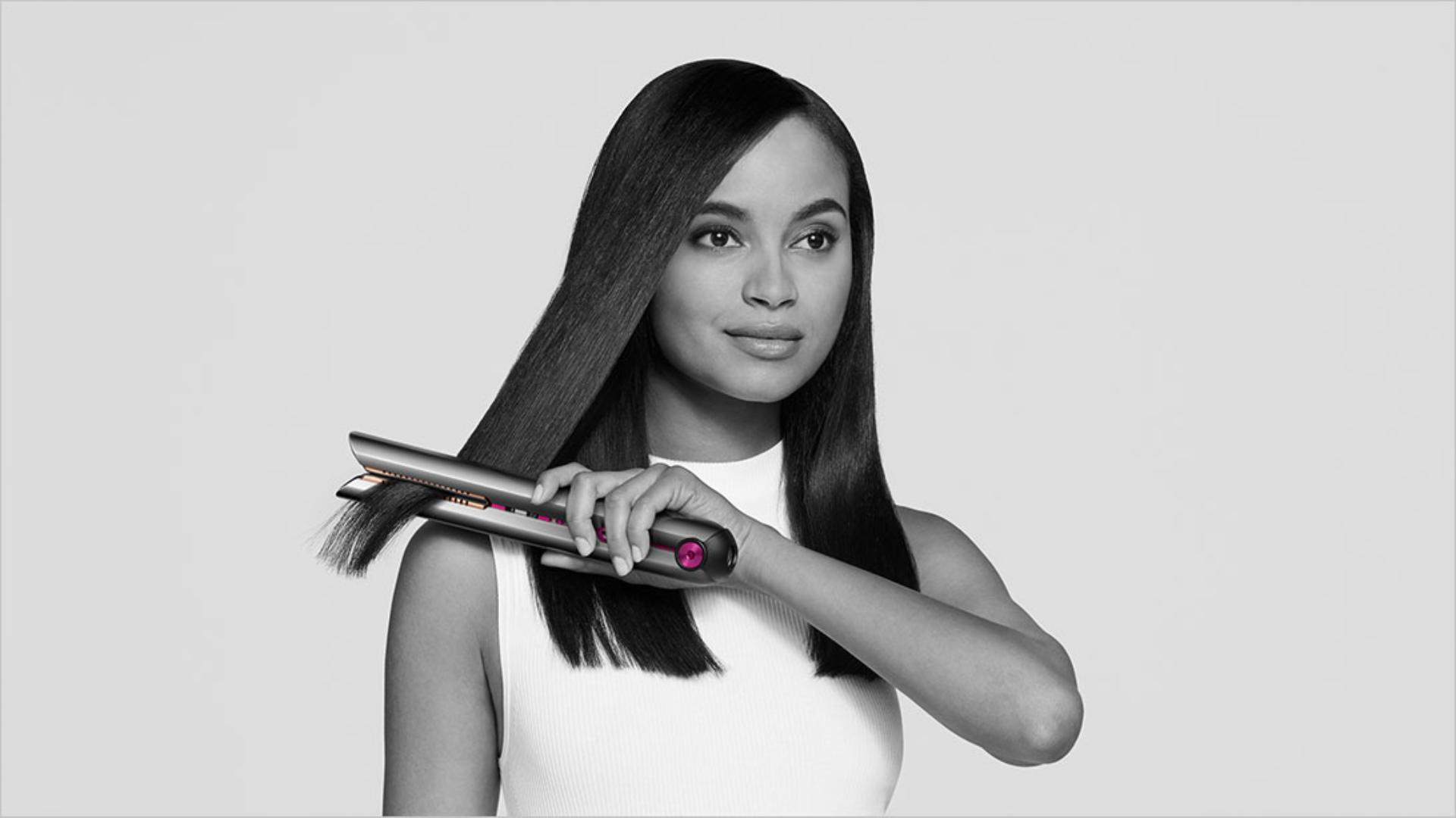 A model using the Dyson Corrale hair straightener