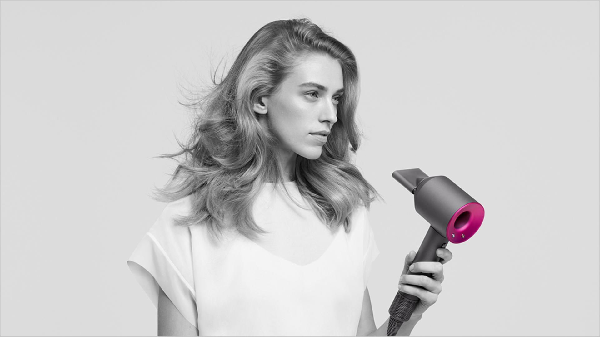 A model using the Dyson Supersonic hair dryer