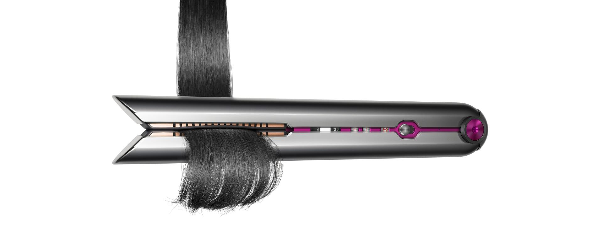 The Dyson Corrale straightener pulling down on a beautifully styled tress of hair