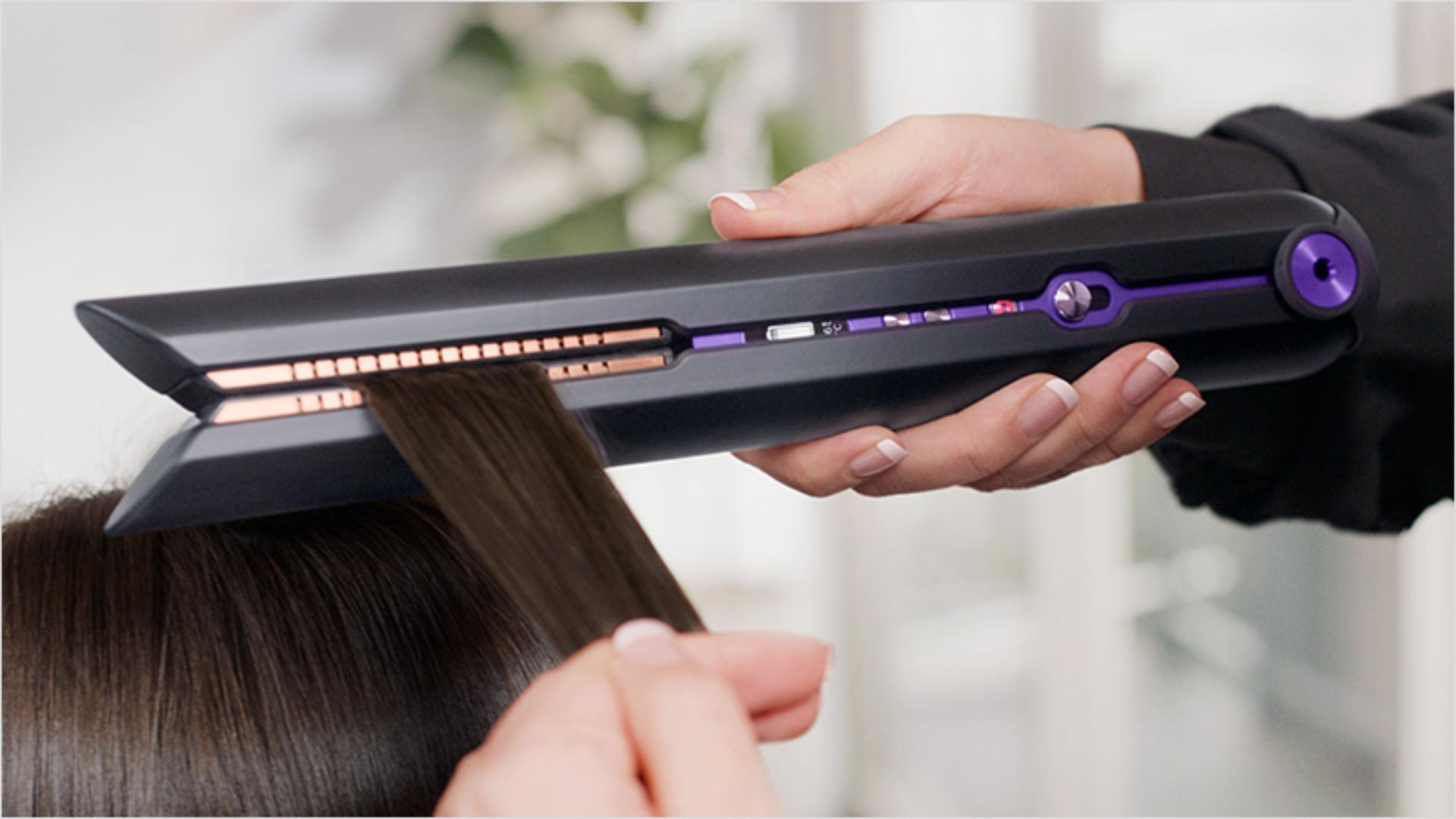 Close up of hair being gathered by the flexing plates on the Dyson Corrale hair straightener