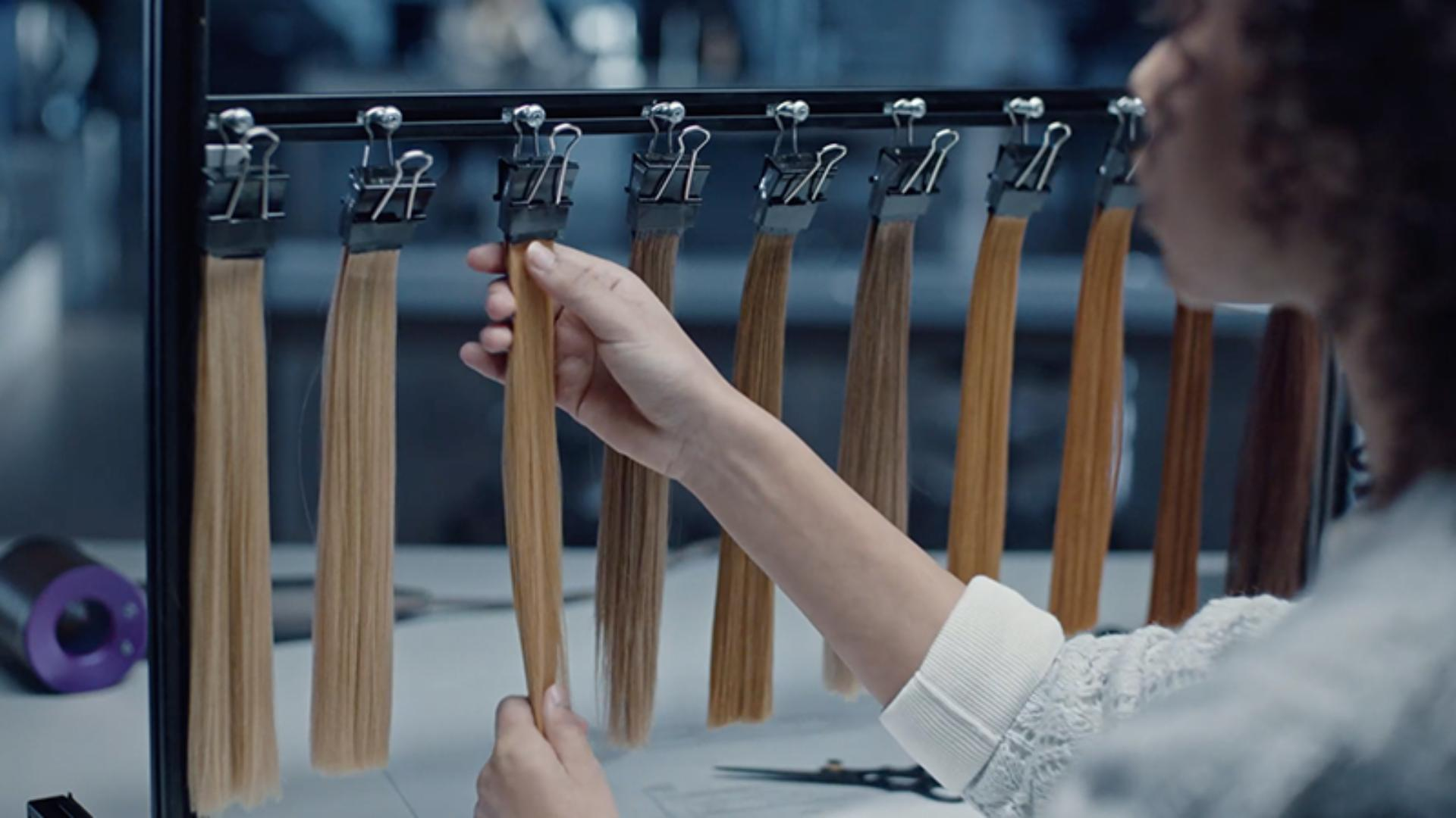 Different coloured hair tresses hanging in a laboratory