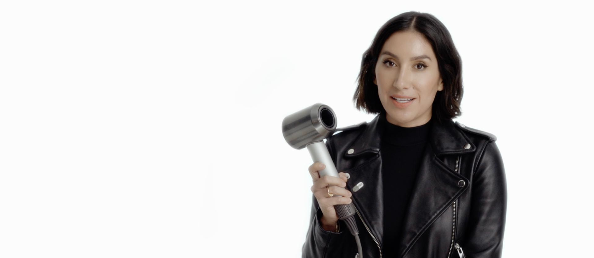 Jen Atkin holding the Dyson Supersonic™ hair dryer Professional edition