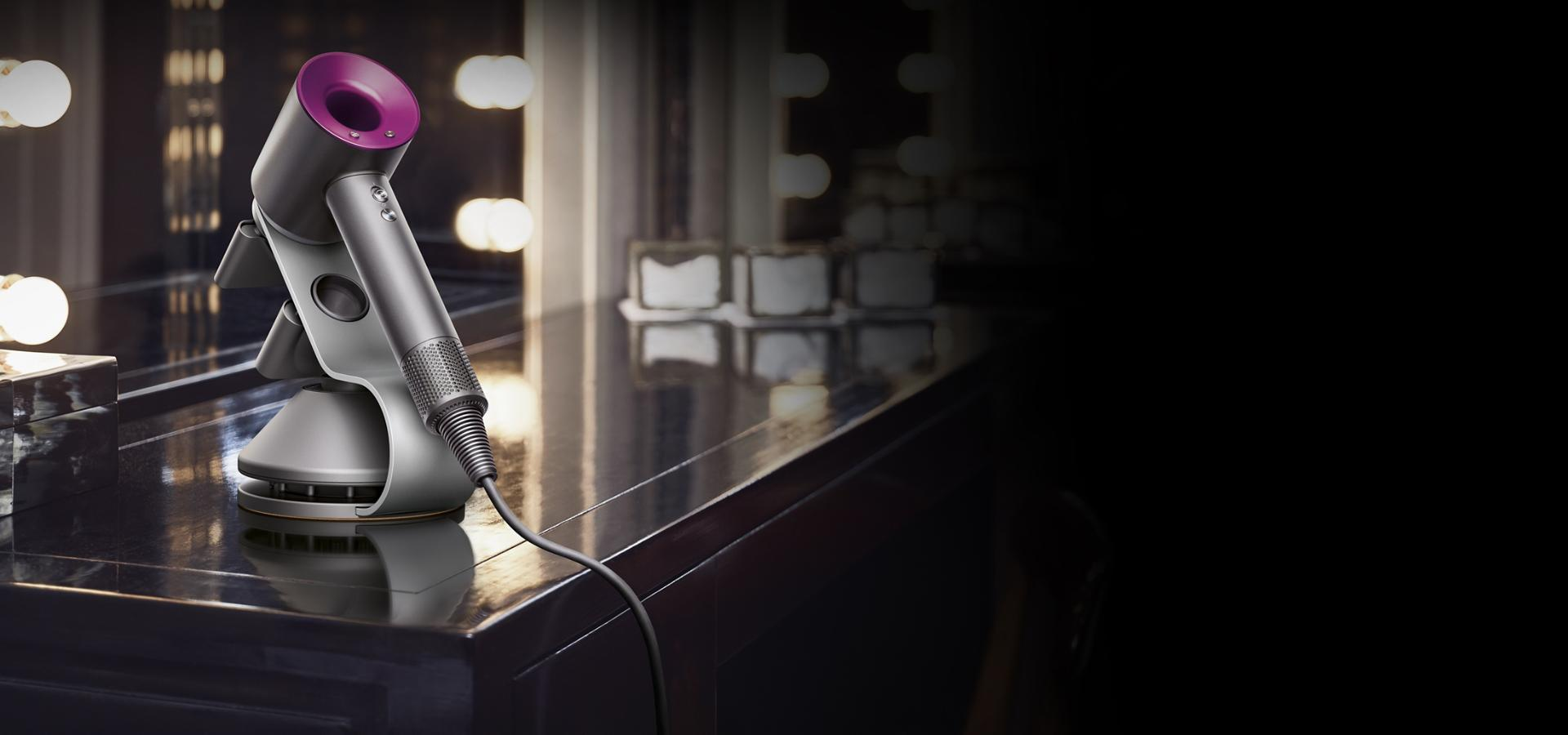 A Dyson Supersonic hair dryer inside a hotel room
