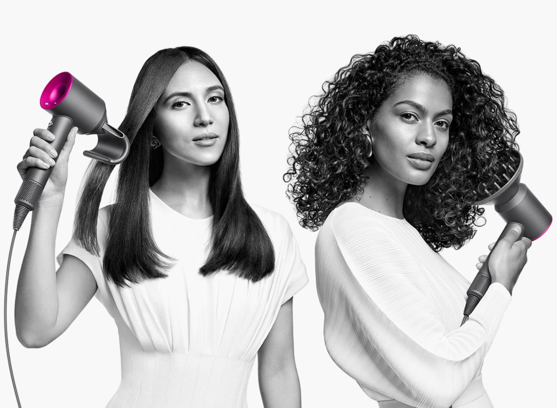 Model using the Dyson Supersonic hair dryer