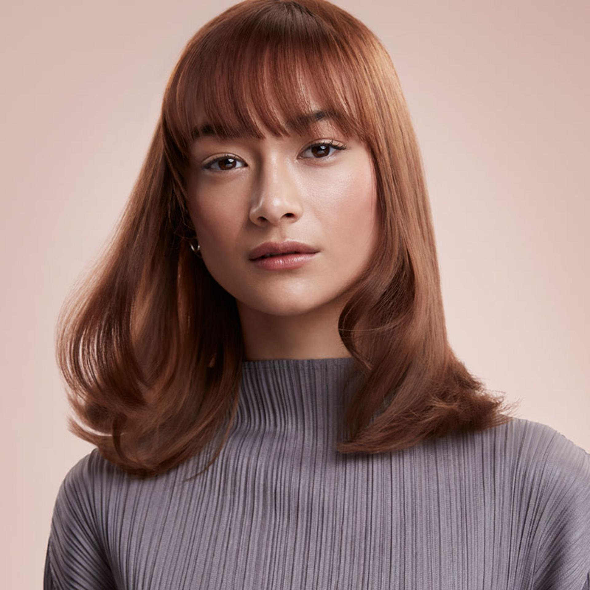 Model with amplified, smooth hair