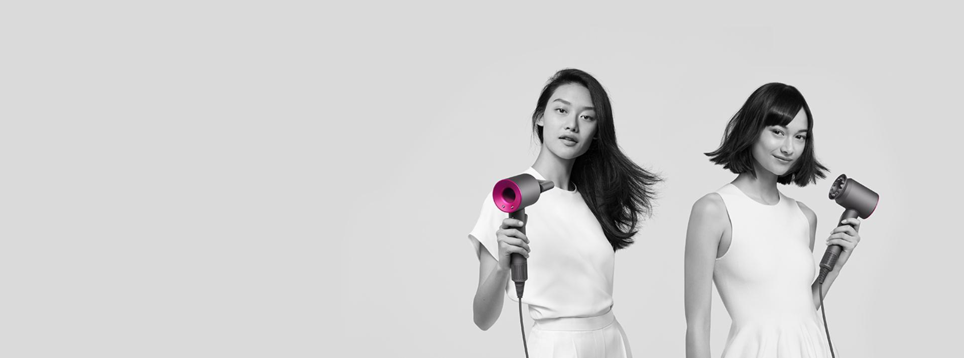 Three women using Dyson Supersonic hair dryers