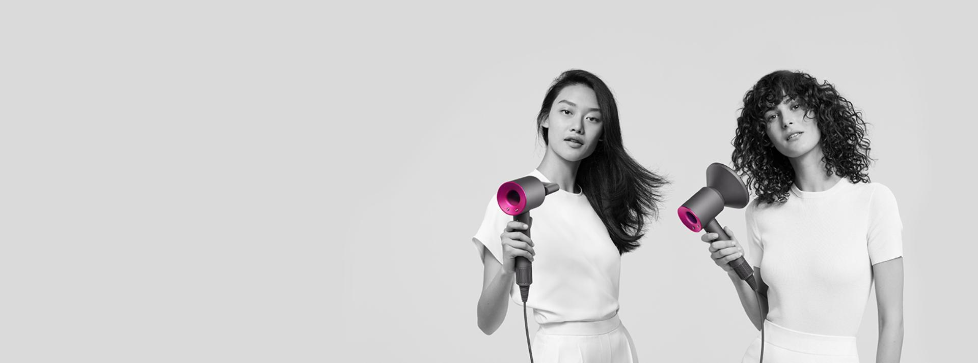 Three women using the Dyson Supersonic to style different types of hair