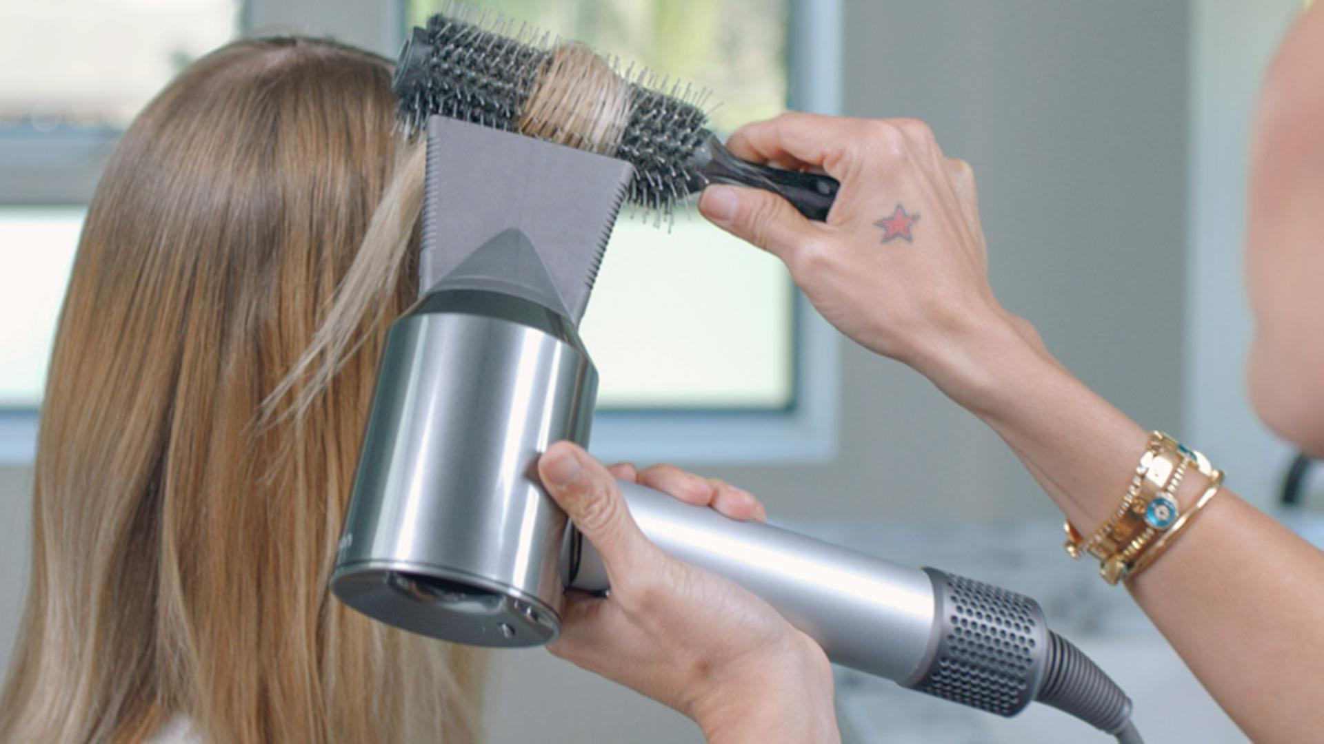 Stylist using the Dyson Supersonic hair dryer Professional