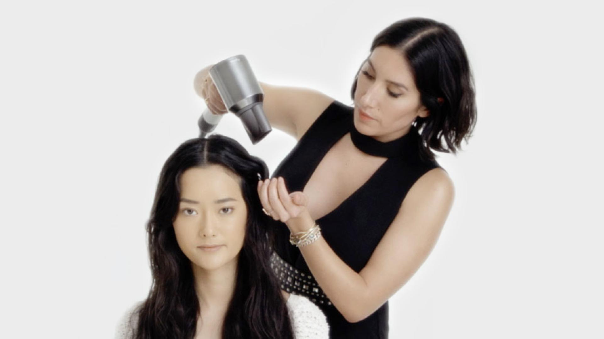 Professional stylist using the Dyson Supersonic hair dryer Professional