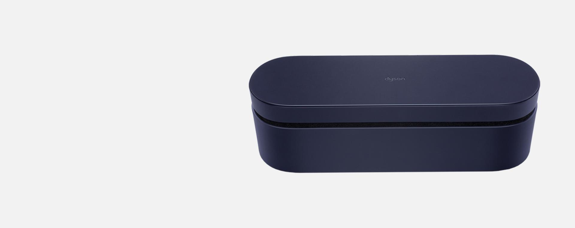 Dark blue Dyson-designed presentation case.