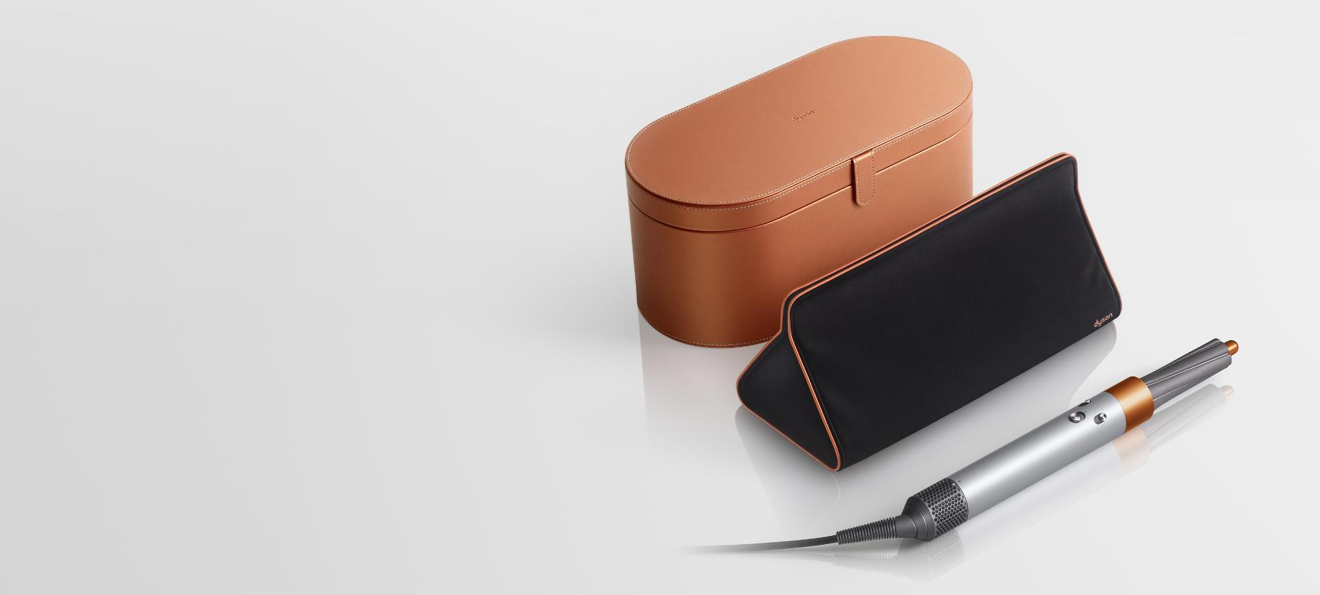 Copper Dyson Airwrap styler with presentation case and storage bag