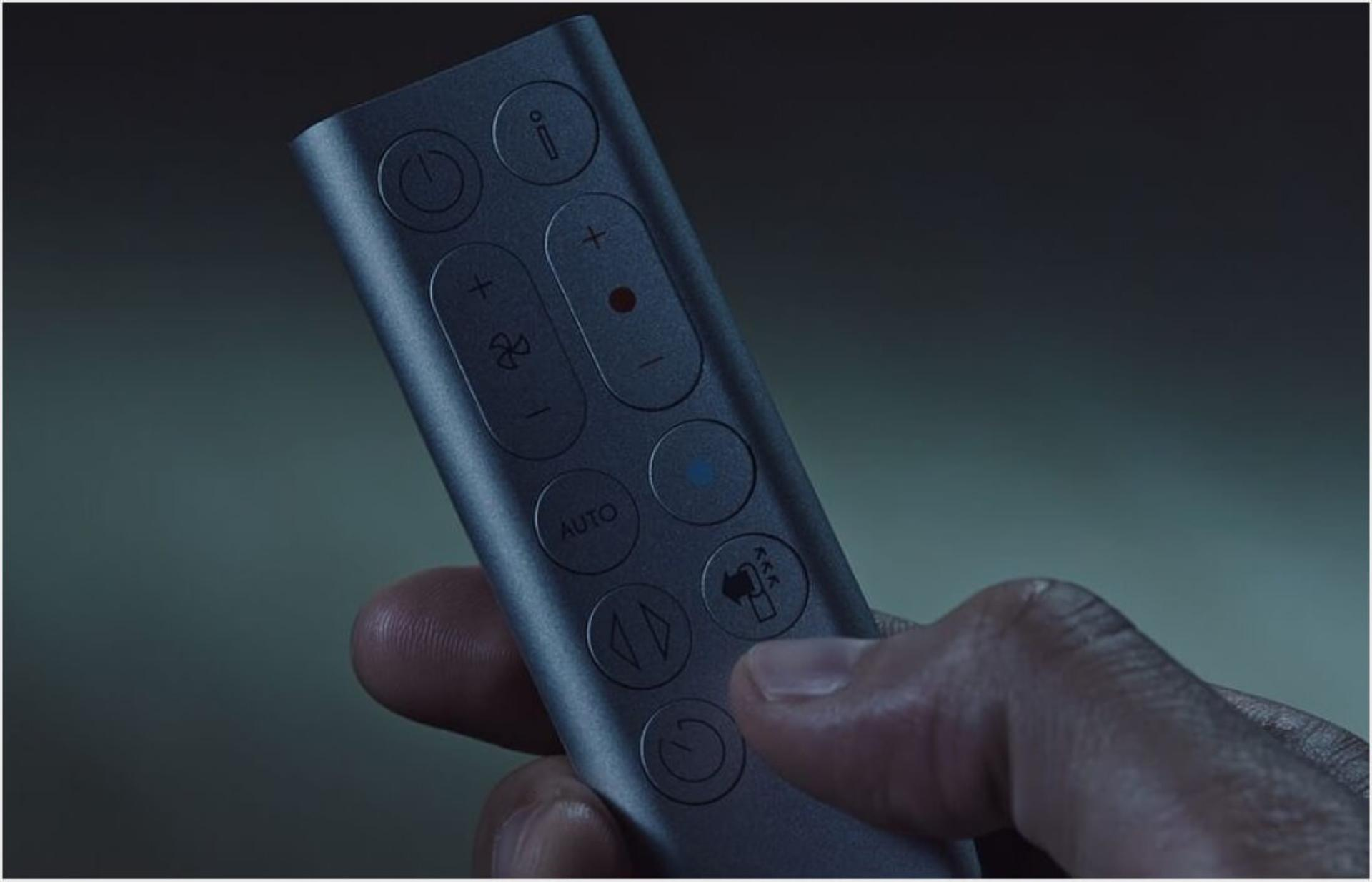 Person setting the Sleep timer using the remote control