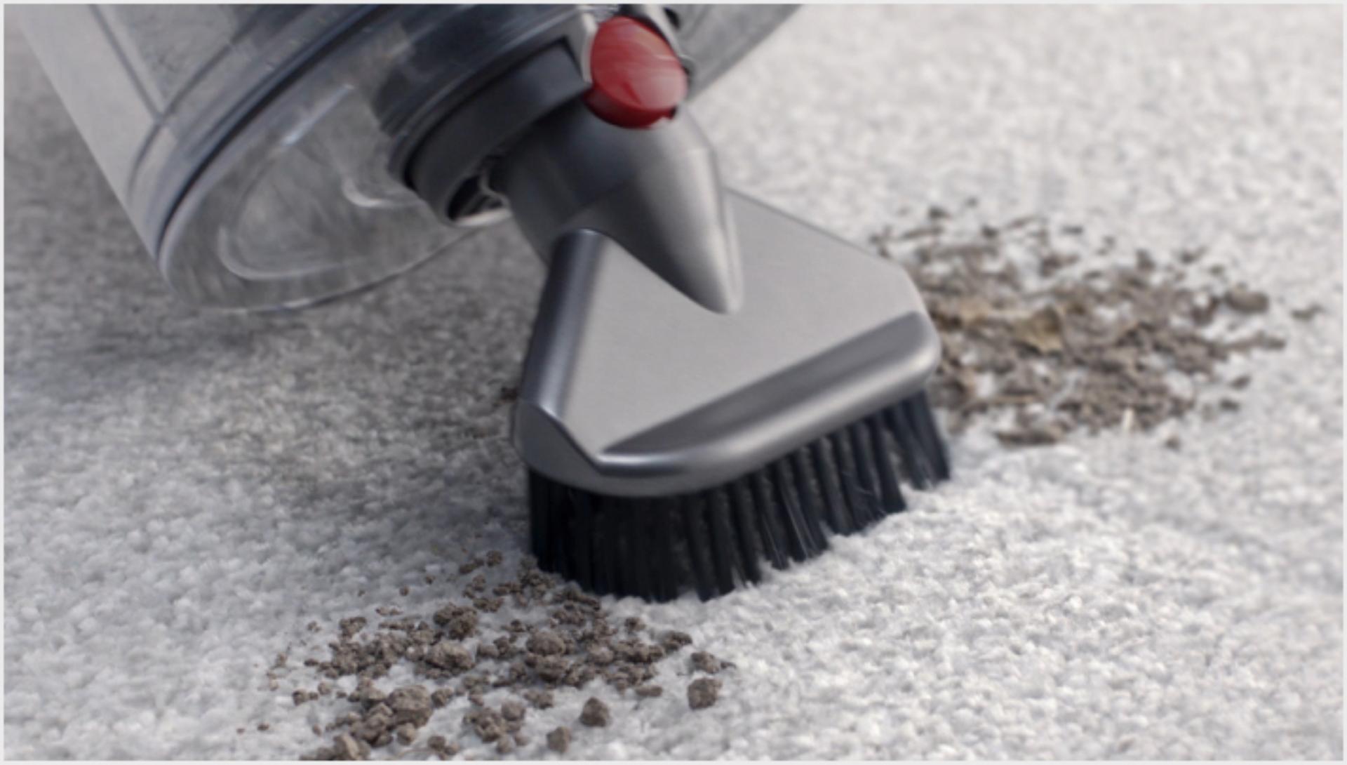Stubborn dirt brush in use