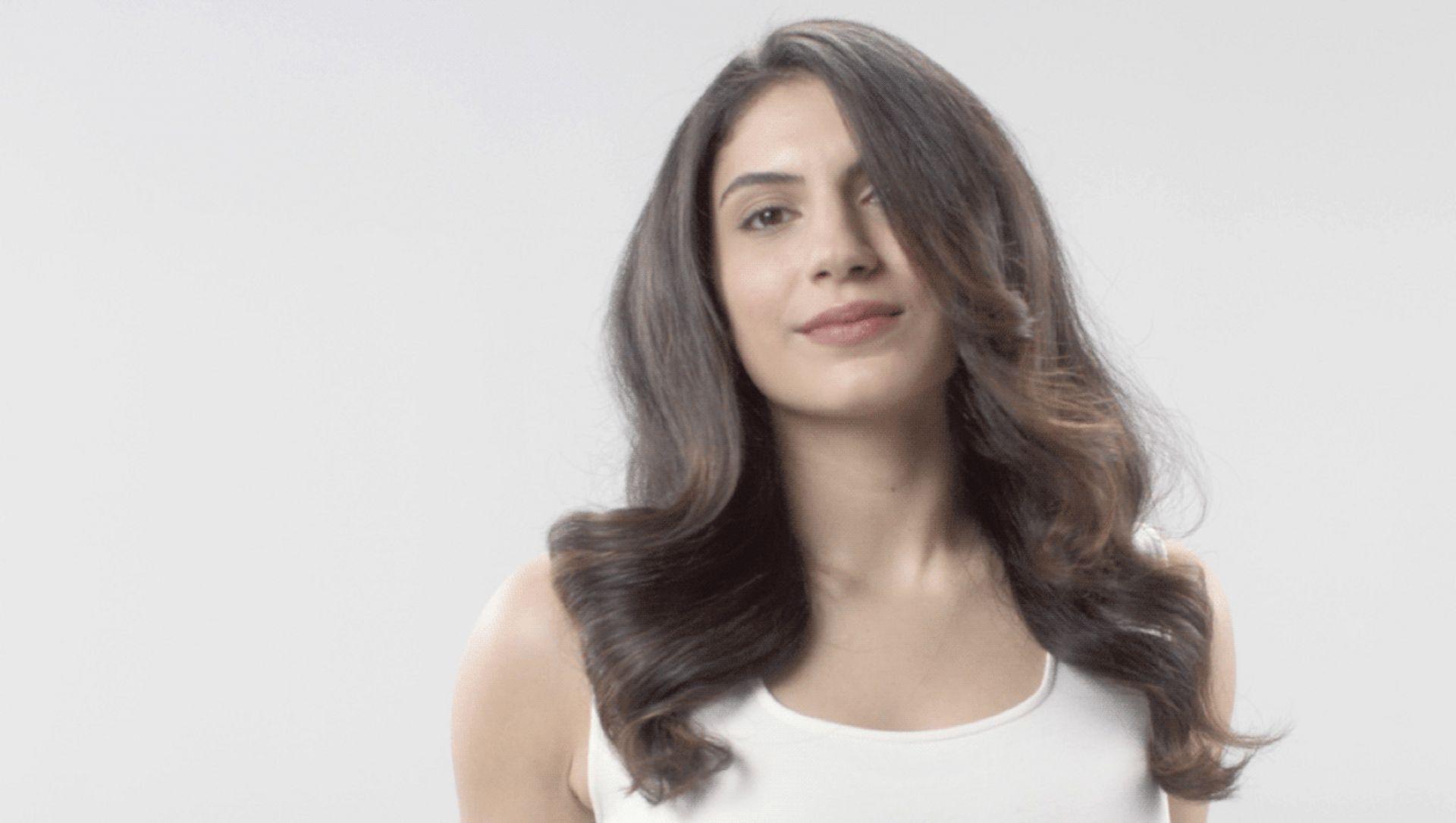 Lady with dark, voluminous hair.