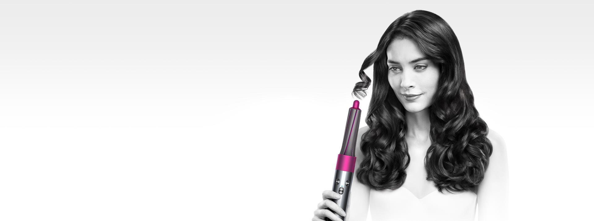 Model using Dyson airwrap styler
