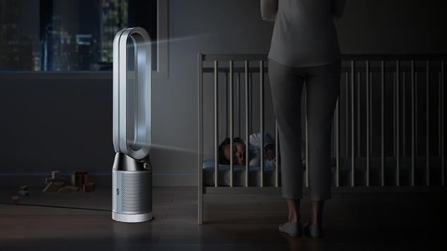 Baby asleep in cot beside Dyson Pure Cool™ purifying fan