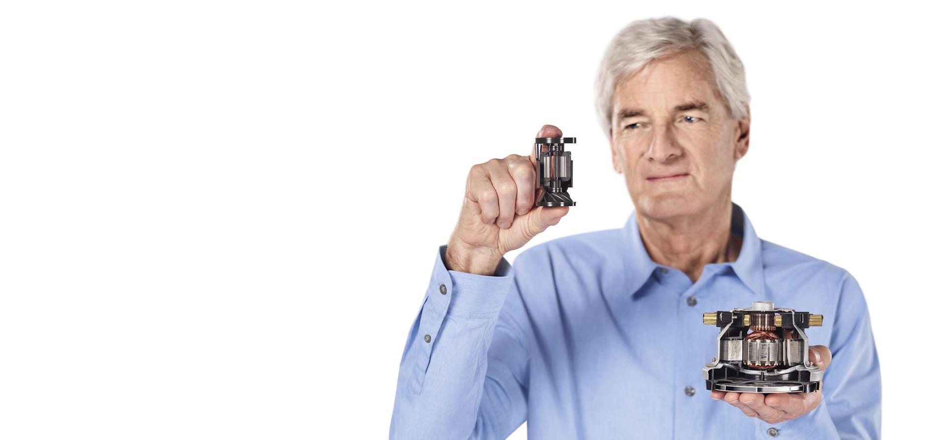 James Dyson holding Dyson digital motor V10